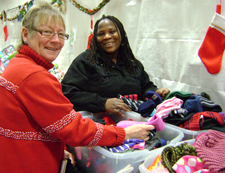 Volunteer assisting shopper